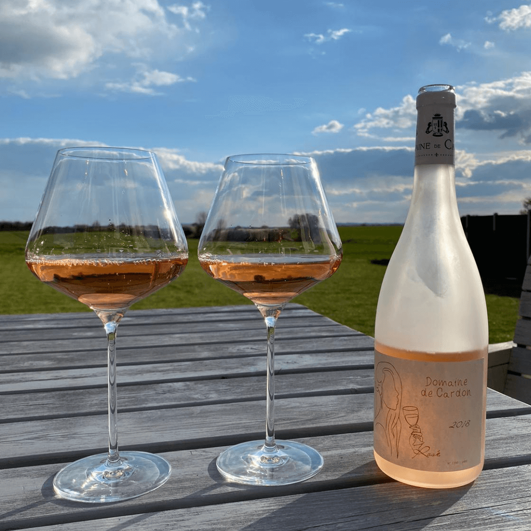 Domaine de Cardon's Rose wine poured into two glasses by the Corky Winers in Essex, England